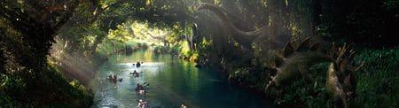 Stegosaurus au bord d'une rivière dans le film Jurassic World.
